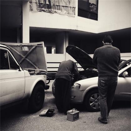 Man changing car battery